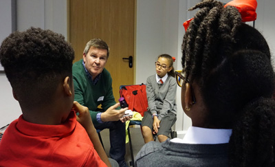 Danny Freeman talks to children about his time as a cabbie